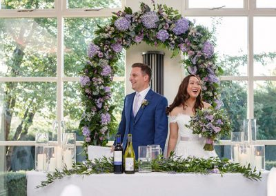 Floral wedding ceremony arch, prop hire shottle hall